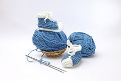 Cute little booties with yarn and knitting needles Stock Image