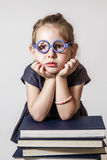 Cute Little Bored Girl Near Books Royalty Free Stock Images