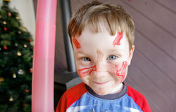 Cute Little Boy. Color portrait of very cute five year old boy with his face painted at Chritmas time stock images