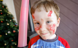 Cute Little Boy. Color portrait of very cute five year old boy with his face painted at Chritmas time royalty free stock photos