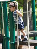 Cute little boy. Playing in the park on a playground set Stock Photos