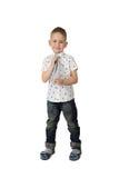 Cute little boy adjusts tie Stock Photography