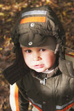 Cute little boy in autumn clothes Stock Photo