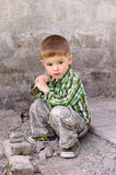 Cute little boy on the background of wall. Cute little boy with a hammer in his hand on the background of wall Stock Photos