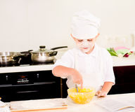 Cute little boy baking in his kitchen at home Royalty Free Stock Image