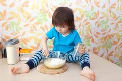 Cute little boy baking Stock Photography