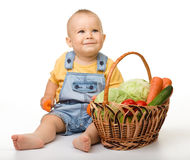 Cute little boy with basket full of vegetables Stock Photo