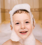 Cute little boy in bathroom with foam, close up portrait, lifestyle people concept Stock Images