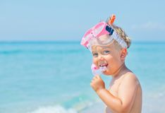 Cute little boy on the beach royalty free stock image