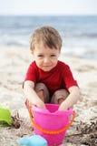 Cute little boy on the beach royalty free stock photo
