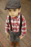 Cute little boy with beautiful eyes looking into the camera Stock Photo