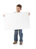 Cute little boy with big blank sheet Royalty Free Stock Photos