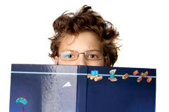 Cute little boy with a big book Stock Photography