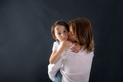 Cute little boy with big bump on his forehead from falling, hugg Stock Photos