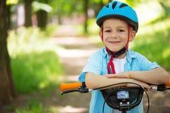 Cute little boy on bike Stock Photos