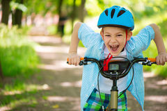 Cute little boy on bike Royalty Free Stock Images