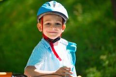 Cute little boy on bike Stock Images