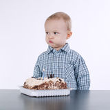 Cute little boy with birthday cake on white Royalty Free Stock Images