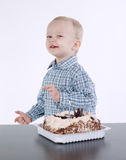 Cute little boy with birthday cake on white Stock Image