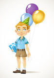 Cute little boy with a birthday gift and balloons Royalty Free Stock Image