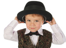 Cute little boy in black hat Stock Images