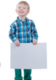 Cute little boy with blank poste Royalty Free Stock Images