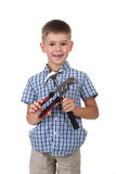 Cute little boy in blue checkered shirt, holding building instruments, isolated on white background.  Royalty Free Stock Image
