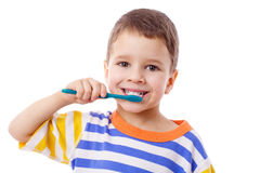 Cute little boy brushing teeth Royalty Free Stock Image