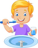 Cute little boy brushing teeth stock illustration