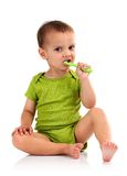 Cute little boy brushing teeth, isolated on white Royalty Free Stock Images