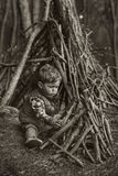 Cute little boy building a wooden hut Royalty Free Stock Images
