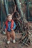 Cute little boy building a wooden hut Royalty Free Stock Photos