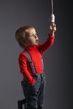 Cute little boy with bulb Stock Images