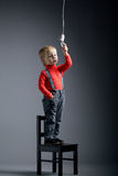 Cute little boy with bulb Royalty Free Stock Photography