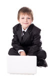 Cute little boy in business suit with laptop isolated on white Royalty Free Stock Photography