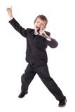 Cute little boy in business suit with microphone singing and dan Royalty Free Stock Images