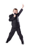 Cute little boy in business suit with microphone singing isolate Stock Photo