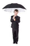 Cute little boy in business suit with umbrella isolated on white Royalty Free Stock Images