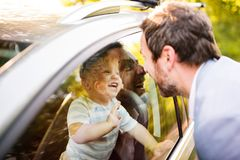 Little boy in the car looking at his father. Royalty Free Stock Image