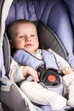 Cute little boy in car seat Stock Photography