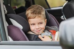 Cute little boy in car sitting in car seat royalty free stock photos