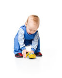 Cute little boy with car toy Stock Images