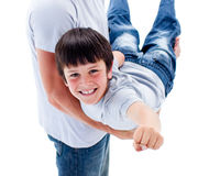 Cute little boy carried by his father Royalty Free Stock Photography