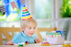 Cute little boy celebrate birthday party with colorful decoration and cake Royalty Free Stock Images