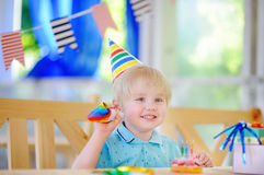 Cute little boy celebrate birthday party with colorful decoration and cake Royalty Free Stock Photo