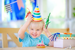 Cute little boy celebrate birthday party with colorful decoration and cake Royalty Free Stock Image