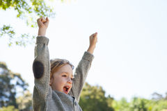 Cute little boy cheering in park Stock Photography