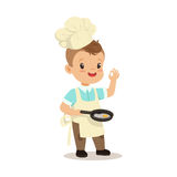 Cute little boy chef frying egg in a flying pan vector Illustration. Isolated on a white background Royalty Free Stock Photo