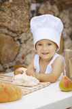 Cute little boy with chef hat Stock Images