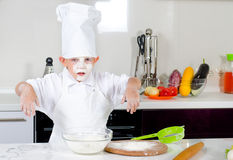 Cute little boy chef in the kitchen Stock Images